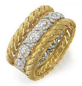 Lot 12 - A Diamond and Gold Bangle Bracelet by Buccellati