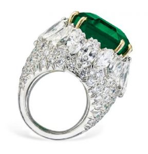 Lot 208 - SIDE VIEW OF THE IMPRESSIVE EMERALD AND DIAMOND RING, BY DAVID WEBB.
