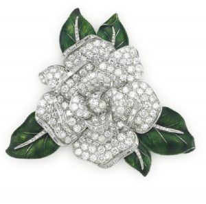 LOT 48 - A DIAMOND AND ENAMEL 'GARDENIA' BROOCH, BY OSCAR HEYMAN & BROTHERS FOR SHREVE & CO