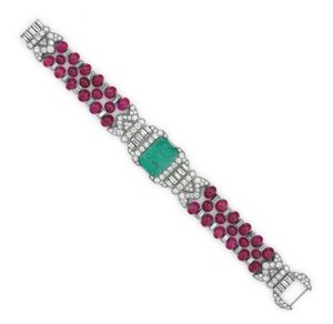 LOT 277 - AN ART DECO EMERALD, RUBY AND DIAMOND BRACELET, BY OSCAR HEYMAN & BROTHERS