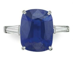 LOT 278 - A SAPPHIRE AND DIAMOND RING, BY HARRY WINSTON