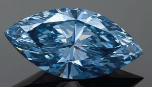 Lot 2079 - 4.29-CARAT MARQUISE-CUT, FANCY VIVID BLUE DIAMOND UNMOUNTED