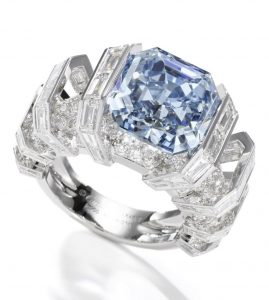 Lot 337 -SIDE VIEW OF THE CARTIER SKY BLUE DIAMOND GEOMETRIC RING SHOWING THE MOUNTINGS OF THE BLUE DIAMOND AND THE ROUND BRILLIANT-CUT AND BAGUETTE-CUT DIAMONDS