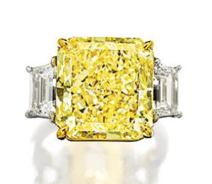LOT 1732 - FANCY INTENSE YELLOW DIAMOND AND DIAMOND RING