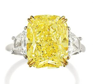 LOT 1693 - FANCY VIVID YELLOW DIAMOND AND DIAMOND RING