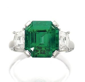 LOT 1694 - EMERALD AND DIAMOND RING