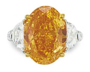 LOT 260 - A RARE COLORED DIAMOND AND DIAMOND RING