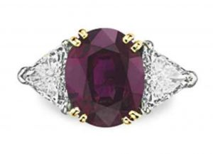 LOT 265 - A RUBY AND DIAMOND RING