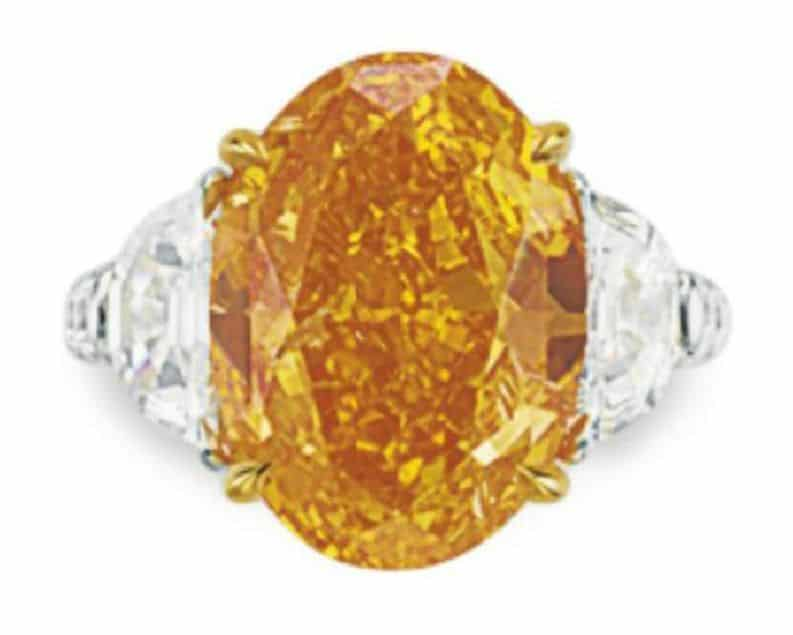 LOT 260 - A RARE COLORED DIAMOND AND DIAMOND RING