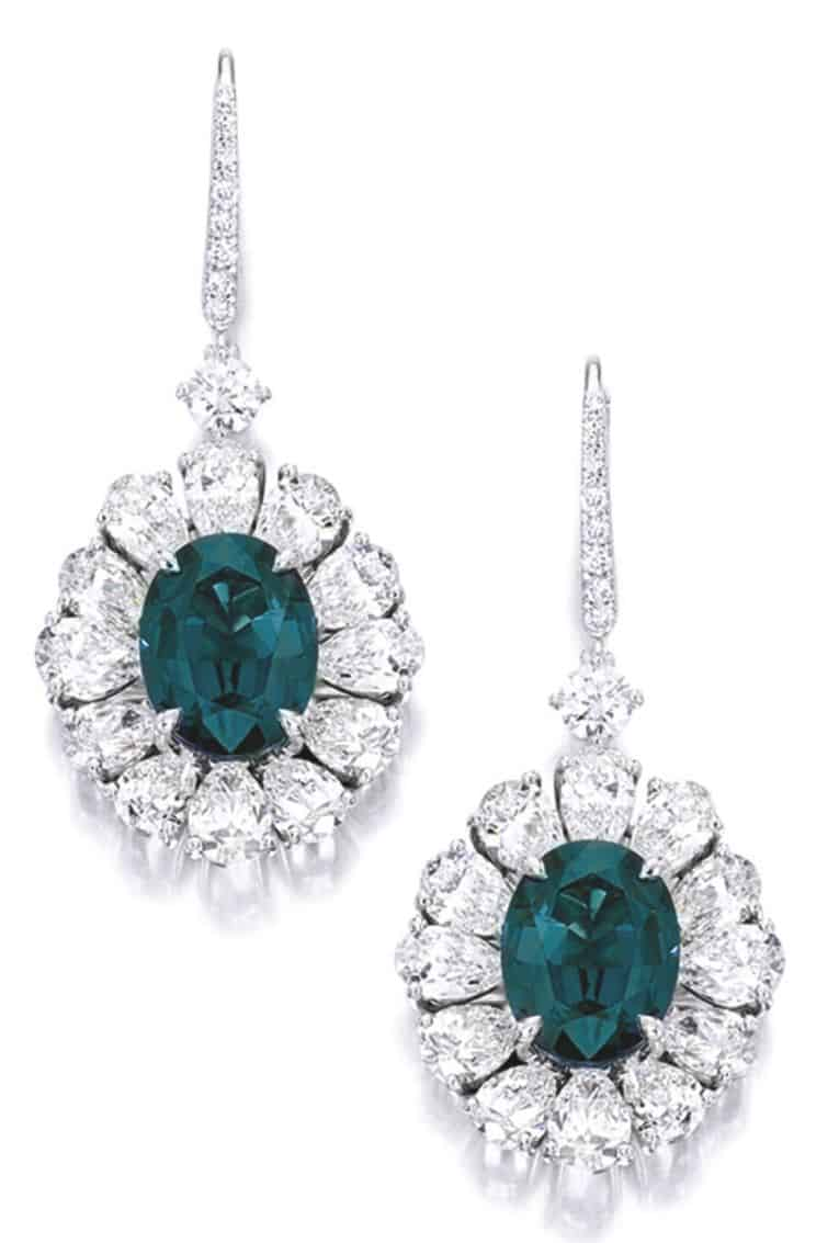 Lot 1758 - Pair of Alexandrite and Diamond Pendent Earrings as seen under daylight
