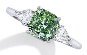 Lot 101 - Rare Platinum, Fancy Vivid Green Diamond and Diamond Ring