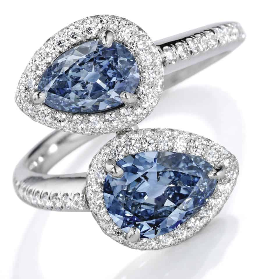 Lot 106 - Exquisite Platinum, Fancy Vivid Blue Diamond and Diamond Ring