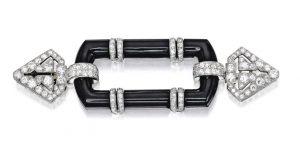 Lot 64 - Platinum Onyx and Diamond Cliquet, Cartier