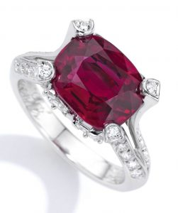 Lot 57 - Platinum, Ruby and Diamond Ring, Van Cleef & Arpels. Four claws that arise by the bifurcation of the upper shank of the ring is shown