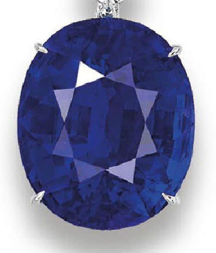 55.56-CARAT, OVAL-SHAPED BLUE SAPPHIRE OF THE CARTIER NECKLACE