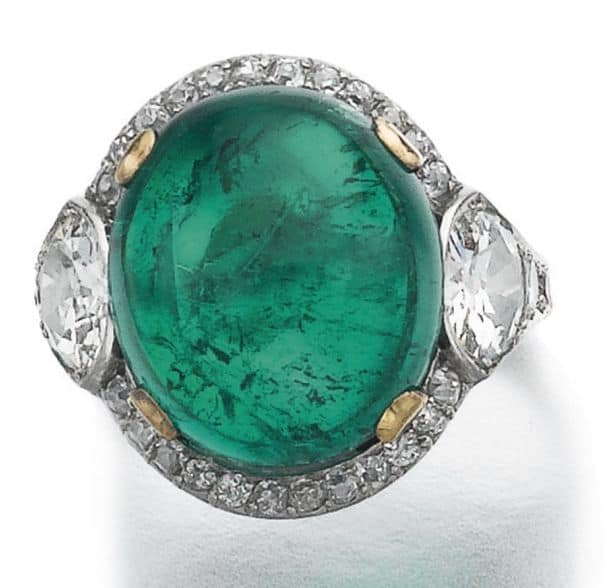 LOT 703 - EMERALD AND DIAMOND RING