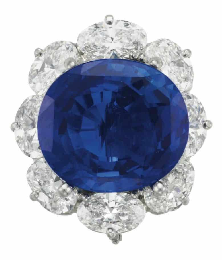LOT 248 - A SAPPHIRE AND DIAMOND RING, BY VAN CLEEF & ARPELS