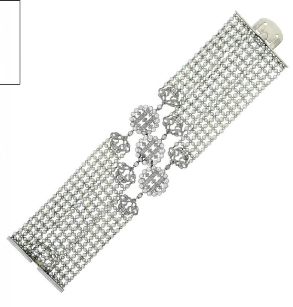LOT 188 - AN ART DECO DIAMOND AND SEED PEARL BRACELET, BY CARTIER