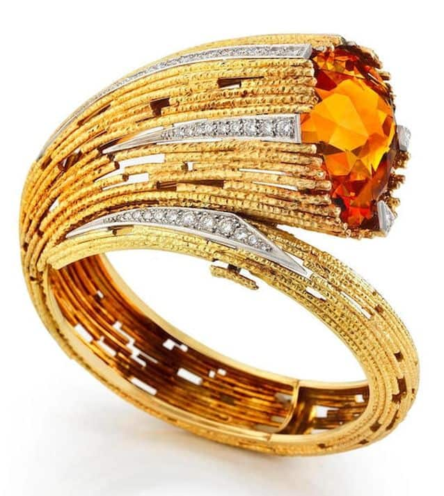 LOT 24 - A CITRINE AND DIAMOND-SET BANGLE, by Grima, 1998