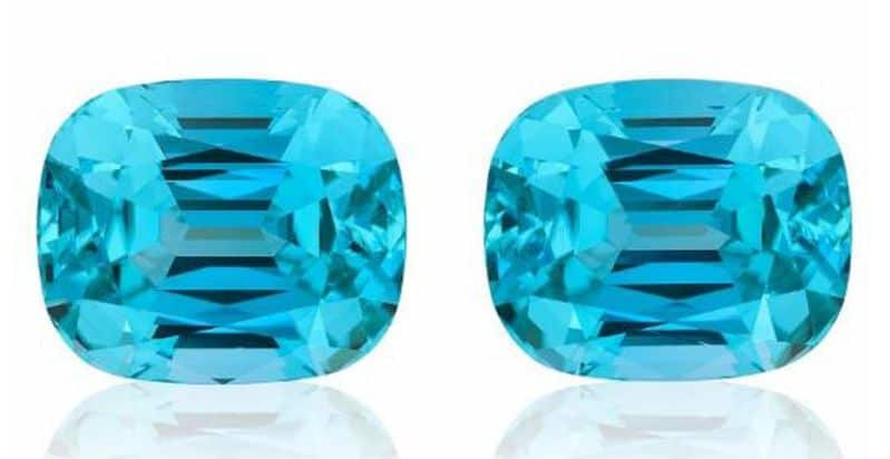 BEST OF SHOW - MIKOLA KUKHARUK NOMADS, PAIR OF NEON BLUE TOURMALINES t.w. 53.56 cts.