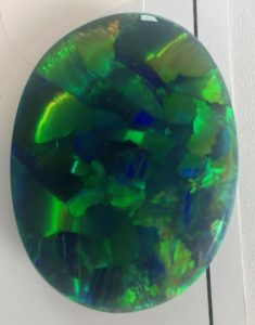 ANOTHER VIEW OF JOEL PRICE 100.66 CT. HARLEQUIN PATTERN BLACK OPAL