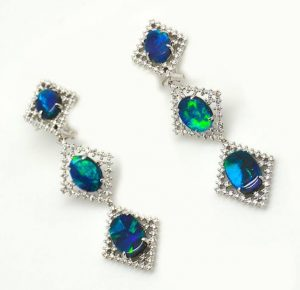 EVENING WEAR PLATINUM HONORS, JOHN FORD, PLATINUM EARRINGS WITH OVAL BLACK OPALS ACCENTED WITH DIAMONDS