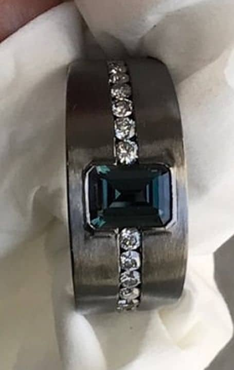 MEN'S WEAR MANUFACTURING HONORS, NIVEET NAGPAL, 18K WHITE GOLD WITH BLACK RHODIUM RING SET WITH 1.07 CT. EMERALD-CUT ALEXANDRITE ACCENTED WITH DIAMONDS AND ALEXANDRITES