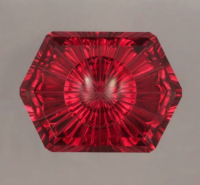 INNOVATIVE FACETING 2ND PLACE, JOHN DYER, 21.58 CT. RED SPINEL HEXAGON