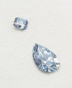 LOT 188 - AN IMPRESSIVE FANCY COLORED DIAMOND TWO-STONE PENDANT