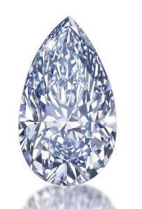 LOT 188 - 4.03-CARAT,FANCY INTENSE BLUE, PEAR-SHAPED DIAMOND AGAINST WHITE BACKGROUND