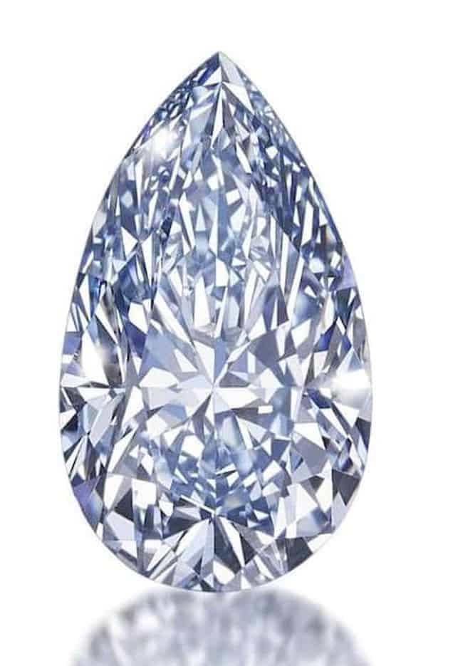 LOT 188 - 4.03-CARAT,FANCY INTENSE BLUE, PEAR-SHAPED DIAMOND AGAINST WHITE BACKGROUND