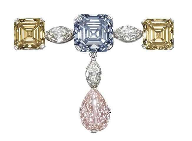 LOT 187 - A FINE FANCY COLORED DIAMOND PENDANT BROOCH AGAINST WHITE BACKGROUND