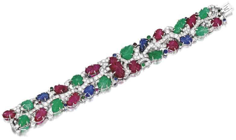 LOT-1860 - VERY RARE AND EXQUISITE ART DECO GEM SET AND DIAMOND BRACELET, 'TUTTI-FRUTTI' CARTIER