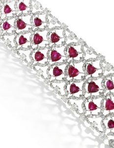 LOT 101 - RUBY AND DIAMOND BRACELET, CHOPARD, SECTION ENLARGED
