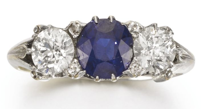 LOT 311 - SAPPHIRE AND DIAMOND WEST & SON RING