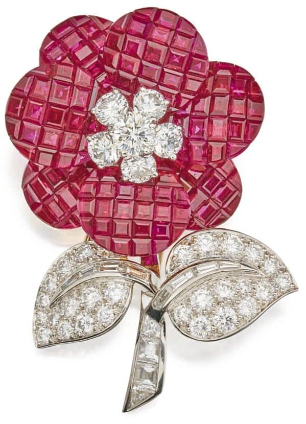 LOT 61 - MYSTERY-SET RUBY AND DIAMOND CLIP-BROOCH, VAN CLEEF & ARPELS, FRANCE