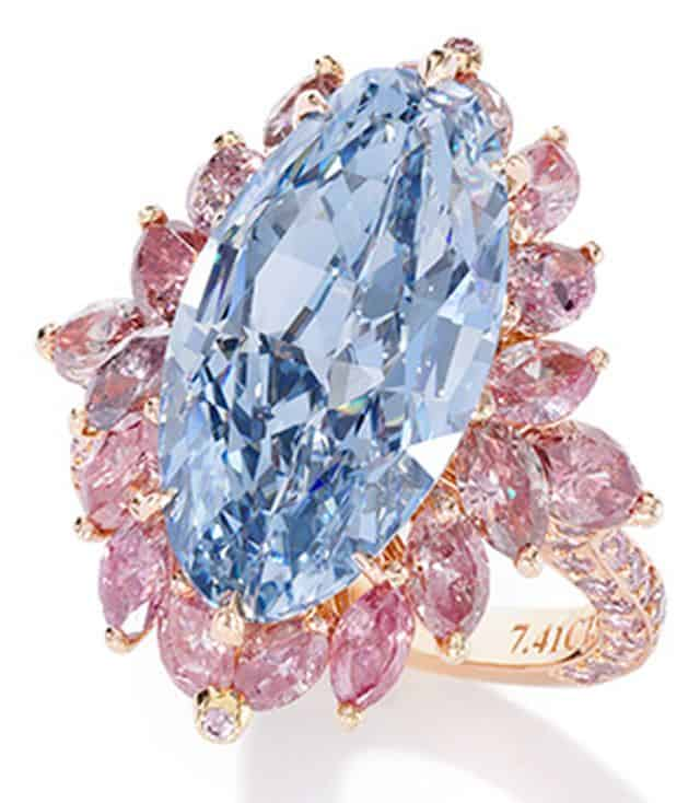 7.41-CARAT, INTERNALLY FLAWLESS, FANCY VIVID BLUE, OVAL BRILLIANT CUT DIAMOND RING