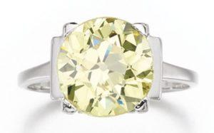 LOT 216 – FANCY INTENSE YELLOW DIAMOND RING