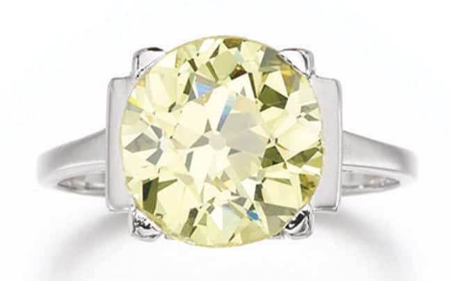 LOT 216 – FANCY INTENSE YELLOW DIAMOND RING