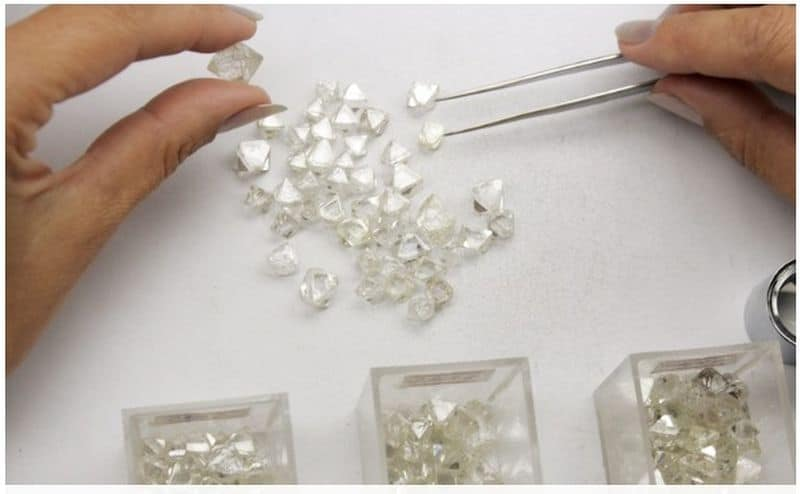 ALROSA ROUGH DIAMONDS ON A GRADER'S TABLE