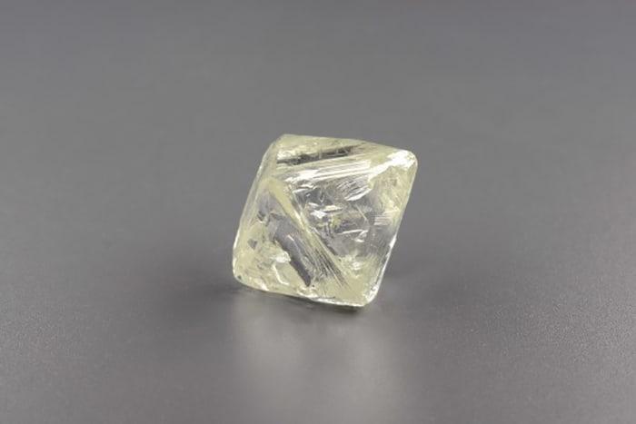 85.62-CARAT, ISOMETRIC OCTAHEDRAL, YELLOWISH HUE, ROUGH DIAMOND