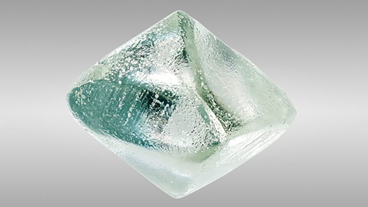 VERY LIGHT GREEN, 9.71-CARAT, SYNTHETIC MOISSANITE CRYSTAL, SUBMITTED TO GIA CARLSBAD LABORATORY