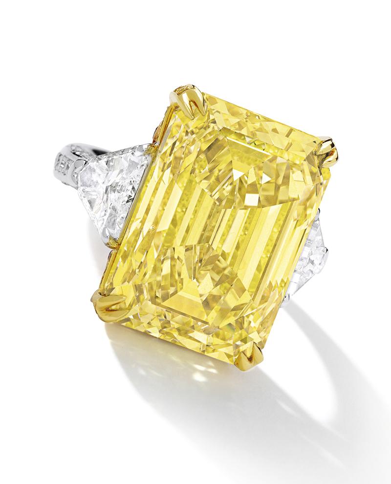 LOT 1659 - AN IMPRESSIVE FANCY VIVID YELLOW DIAMOND AND DIAMOND RING
