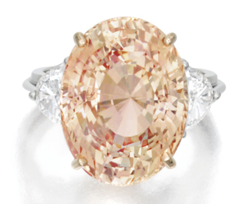 LOT 1623 - PADPARADSCHA SAPPHIRE AND DIAMOND RING