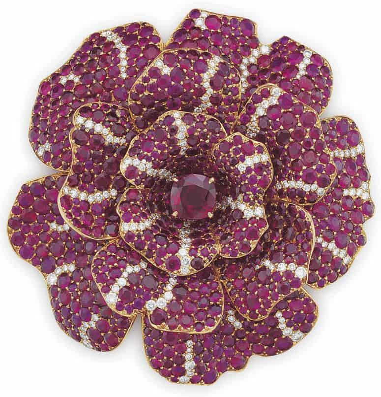 LOT 210 - AN ELEGANT RUBY AND DIAMOND 'CAMELLIA' BROOCH, BY CHANEL