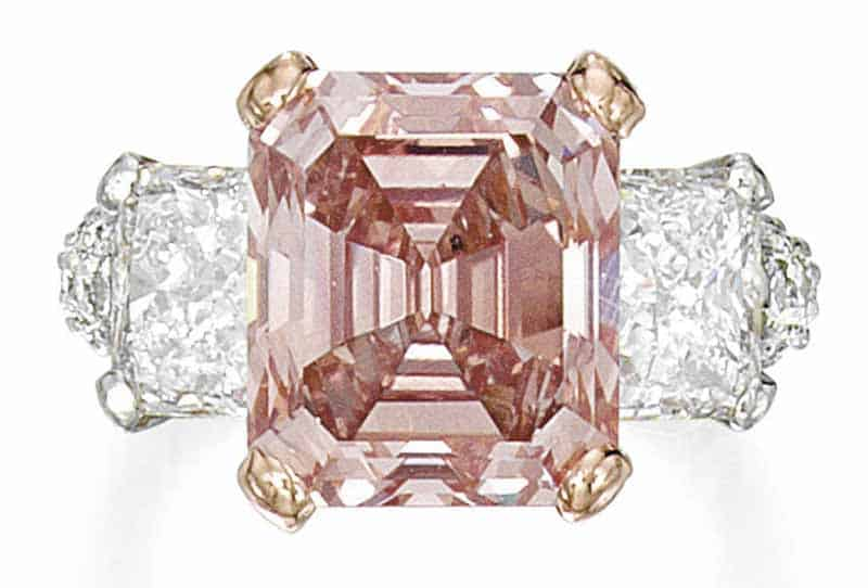 LOT 48 - AN IMPORTANT FANCY INTENSE ORANGY PINK DIAMOND AND DIAMOND