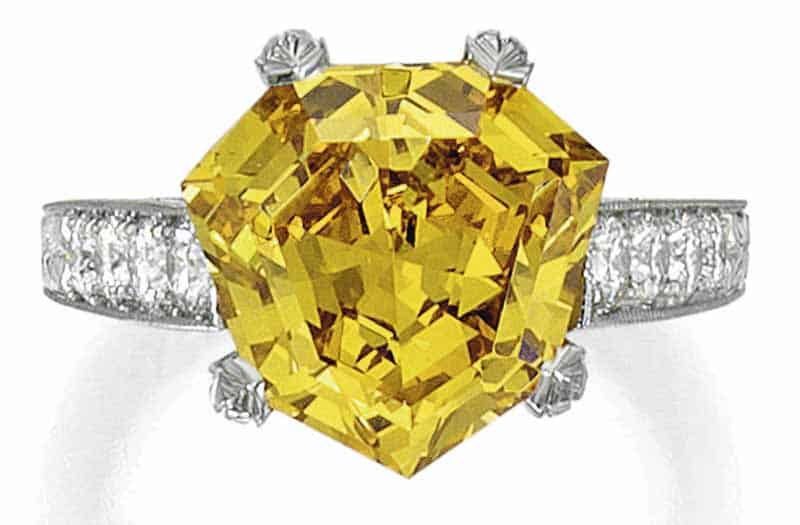 LOT 90 - FANCY VIVID YELLOW-ORANGE DIAMOND AND DIAMOND RING