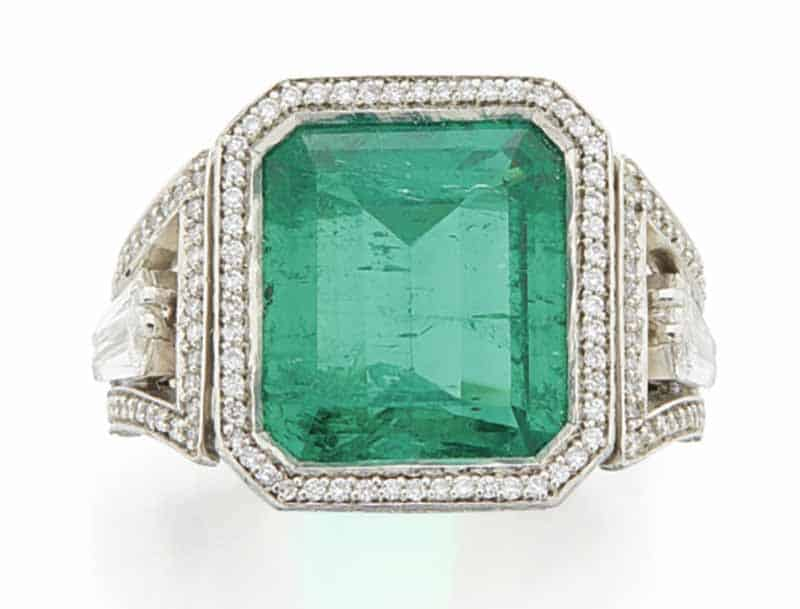 LOT 748 - EMERALD AND DIMOND RING
