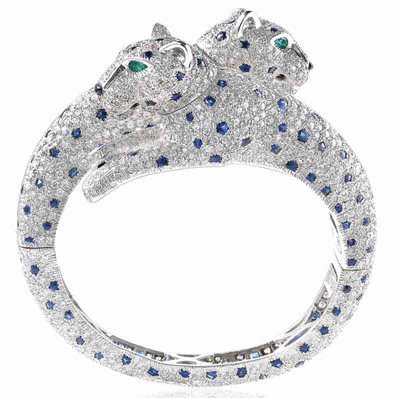 LOT 390 - DIAMOND, SAPPHIRE, ONYX AND EMERALD 'PANTHÈRE' BANGLE, CARTIER