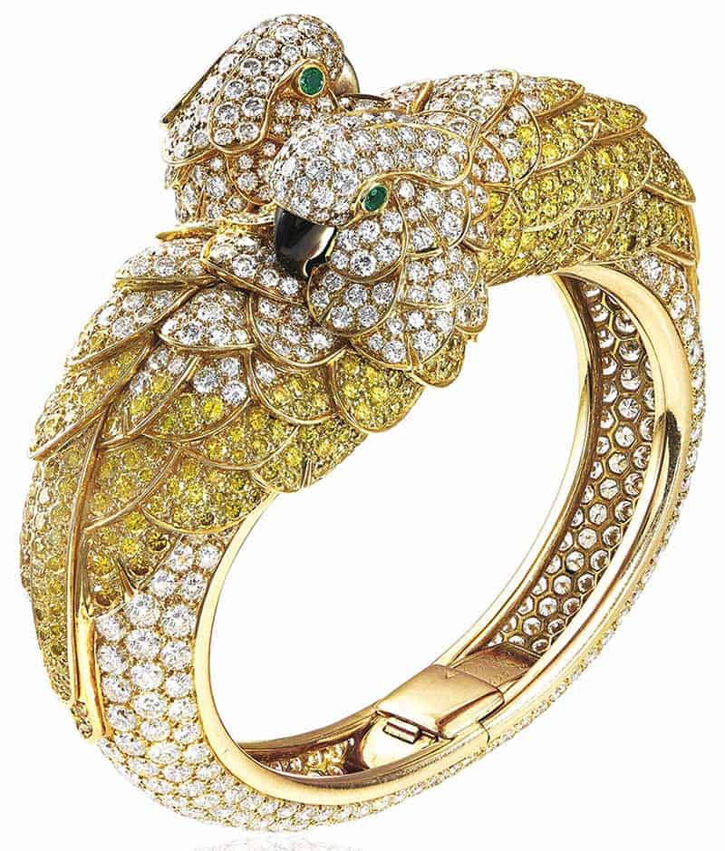 LOT 411 - COLOURED DIAMOND, EMERALD, MOTHER-OF-PEARL AND DIAMOND 'LES OISEAUX LIBÉRÉS' BANGLE, CARTIER